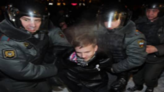 Moscow riot police detain an activist during an unsacnctioned anti-Putin opposition rally at the Pushkin Square March 5, 2012 in central Moscow, Russia.