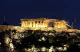 The Parthenon, illuminated at night, sits at the top of Acropolis hill in Athens, Greece, on Monday, Feb. 13, 2012.