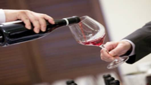 red-wine-being-poured-into-glass_200.jpg