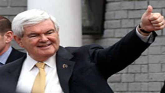Republican presidential candidate, former Speaker of the House Newt Gingrich gives a thumbs up sign to supporters after speaking to the Vestavia Hills Chamber of Commerce at the Vestavia Hills Country Club March 13, 2012 in Birmingham, Alabama