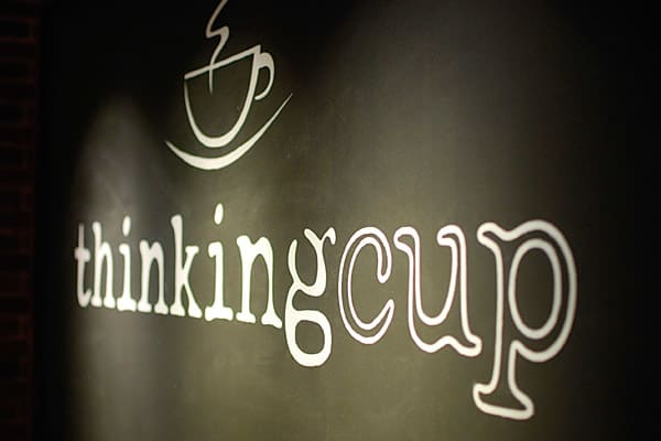 """Location: BostonBest-seller: Espresso beverages Since opening its doors in December 2010,  has gained accolades from a number of outlets. Besides being one of Krups' top 10 coffee shops, it has also been named to Boston magazine's Best of Boston 2011, boston.com's 2011 A List, and Stuff Magazine's Hot 100. The café serves Stumptown Coffee, roasted in Brooklyn, N.Y. Thinking Cup owner Hugh Geiger says that he likes being able to """"provide a place for people to come together to relax and socialize"""