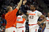 James Southerland #43 of the Syracuse Orange celebrates with his teammates after a point against the UNC Asheville Bulldogs during the second round of the 2012 NCAA Men's Basketball Tournament.