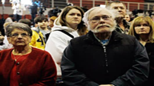 People wait to hear the results of Super Tuesday as they attend the Republican presidential candidate, former U.S. Sen. Rick Santorum primary night party at the Steubenville High School Gymnasium on March 6, 2012 in Steubenville, Ohio.