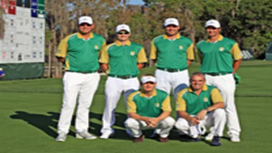 Members of the Queenwood Team (kneeling l-r) Soren Kjeldsen of Denmark, Paul McGinley of Ireland, (standing l-r) Thomas Bjorn of Ireland, Tom Lewis of England, David Howell of England, and Adam Scott of Australia during the first day of the 2012 T