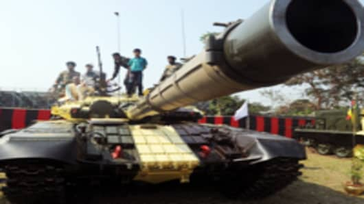Civilian visitors sit on top of a T-72 tank during an Indian Army weaponry exhibition in Kolkata, India.