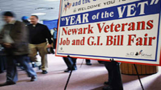 U.S. military veterans arrive to meet potential employers at a job fair for former servicemen and women on the campus of Rutgers University on March 13, 2012 in Newark, New Jersey