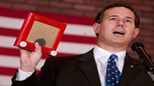 Republican presidential candidate, former U.S. Sen. Rick Santorum holds up an Etch-A-Sketch as he speaks to supporters at a 'Rally for Rick' in Fond du Lac, Wisconsin.