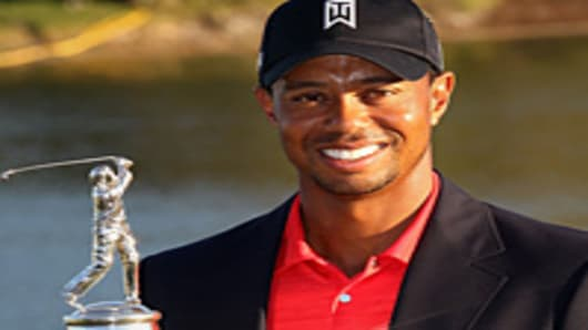 Tiger Woods holds the trophy after winning the Arnold Palmer Invitational presented by MasterCard at the Bay Hill Club and Lodge.