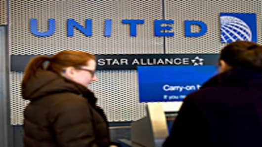 A passenger checks in at a United Continental Holdings Inc. kiosk.