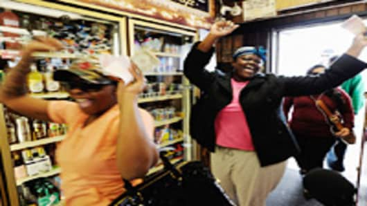 Tammy Redlen (C) and Sierra Luchien (L) are jubilant as they walk in Bluebird liquor store after waiting in line for nearly three hours to purchase their Mega Millions lottery ticket on March 29, 2012 in Hawthorne, California.