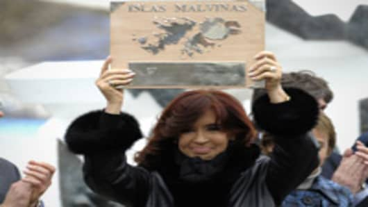 Argentine President Cristina Fernandez de Kirchner holds a plaque before delivering a speech during a ceremony to mark the 30th Anniversary of the 1982 South Atlantic war between Argentina and the Britain over the Falkland Islands (Malvinas).
