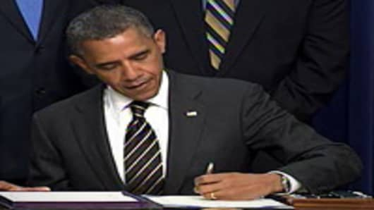 President Barack Obama signs the Stock Act.