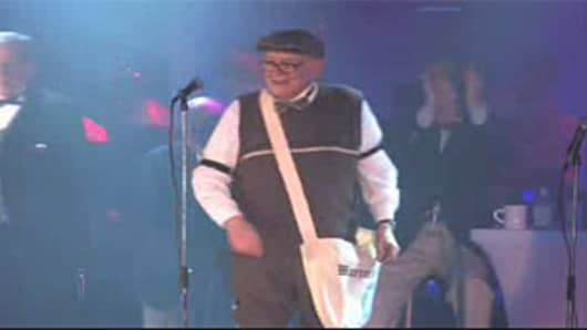 "Warren Buffett, in a screen grab from an Omaha World-Herald video, sings ""I'm Only a Paperboy"" at the Omaha Press Club show on March 31, 2012."