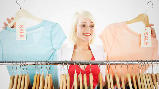 woman-shopping-bright-shirts-200.jpg