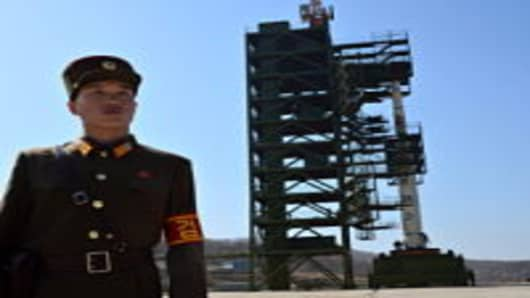 A North Korean soldier stands guard in front of the Unha-3 rocket at Tangachai -ri space center on April 8, 2012.