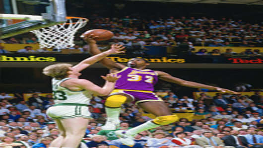 JUNE 1985: Earvin Magic Johnson #32 of the Los Angeles Lakers goes up to shoot over Larry Bird #33 of the Boston Celtics during the 1985 NBA Basketball Finals at the Boston Garden in Boston, Massachusetts.