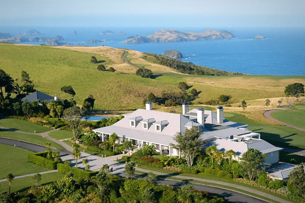 Starts at $623 a night per person, double occupancy, with meals and drinks all-in. For $7,171 nightly, though, you can book the 4,200-square-foot Owner's Suite, with a private infinity pool and kitchen—so the chef can come to you.poised on the edge of the Totara forest, offers panoramic ocean views in 22 guest rooms with his-and-her walk-in closets on 6,000-acres. The resort is owned by American hedge-fund tycoon Julian Robertson.  Hop Air New Zealand's daily 40-minute flight to Kerikeri Bay fr