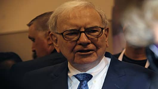 Warren Buffett visits the exhibition hall before answering shareholders' questions at Berkshire annual meeting.
