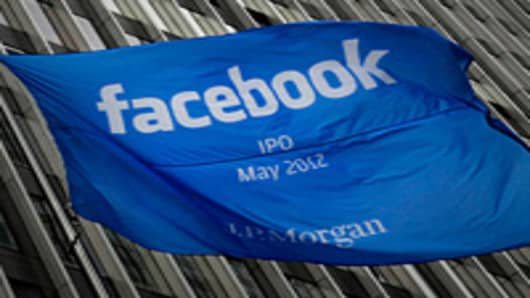 A Facebook Inc. IPO announcement flag flies outside of JPMorgan Chase & Co. headquarters in New York.