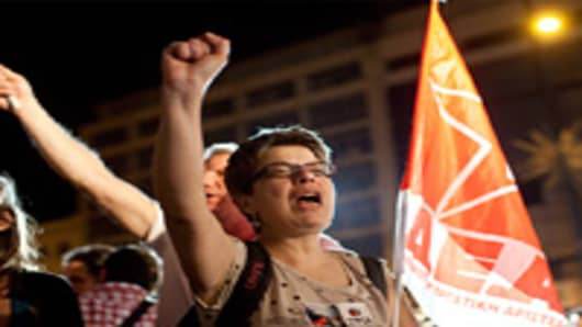 Supporters of Alexis Tsipras, the head of Syriza, celebrate outside the political party's election tent after beating the Pasok party in the parliamentary elections in Athens, Greece, on Sunday, May 6, 2012.