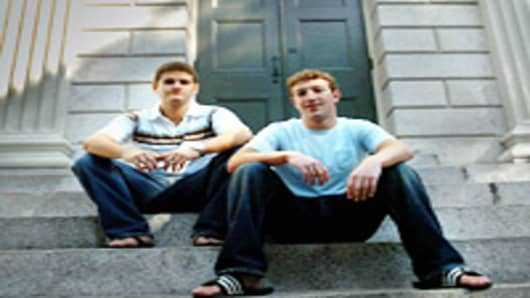 Founder of Facebook.com Mark Zuckerberg, right, and Dustin Moscovitz, co-founder, left; have their photo taken at Harvard Yard.