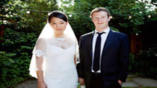Priscilla Chan and Mark Zuckerberg wed in ceremony held in the backyard of their home in Palo Alto, May 19 2012.