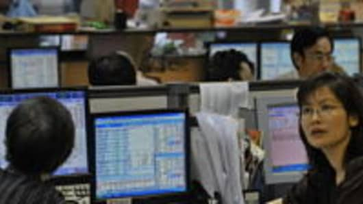 Day traders at a local brokerage in Hong Kong