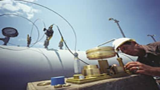 Engineer testing natural gas pipeline.