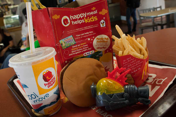 "Since 1979, children have delighted in the McDonald's Happy Meal, a repast marketed specifically at them in which the hamburger and French Fries are accompanied by a toy. But in 2011, the meals got markedly less happy when the San Francisco Board of Supervisors banning the inclusion of toys from the meals unless they met stringent nutritional standards — they had to have less than 600 calories, they had to contain fruits and vegetables, and the beverages could not have ""excessive fat or sugar."""