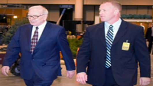 Warren Buffett and his bodyguard, Dan Clark