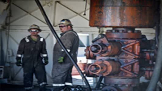 Workers chat at gas drilling rig exploring the Marcellus Shale.