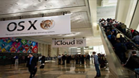 Attendees line up to enter Moscone West ahead of the Apple Worldwide Developers Conference in San Francisco, California.