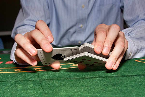 This casino cheat needs the participation of the casino's card dealer to work. The dealer employs a false shuffle, which is meant to look like a regular shuffle but secretly leaves some cards in place. That allows the players involved in the conspiracy, who have been tracking the cards, to know when the unshuffled cards are dealt. It was a scam used to great effect by the Tran Organization. The gang hit casinos all over the U.S., pocketing up to $7 million in false shuffle mini-baccarat and blac