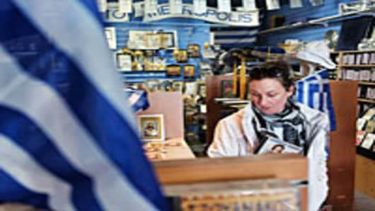 A woman browses Greek merchandise in Oakleigh, a suburb of Melbourne, Australia.