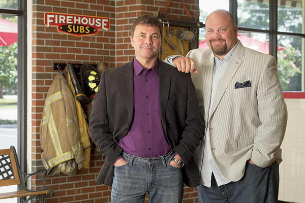 "Chris and Robin Sorensen were both firefighters in Florida when they came up with the idea to open a sandwich shop based on their family's 200 year history of fighting fires. In 1994, the brothers borrowed on a credit card belonging to Robin's in-laws and opened their first shop, decorated with fire equipment and a hand-painted mural that depicted the local fire department. They even gave their subs firefighter-inspired names like ""Hook & Ladder"" and ""Engine Company."" Robin worked at the store w"