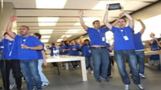 Apple Store employees cheer during the opening of the Apple Store Porta di Roma on April 21, 2012 in Rome, Italy.