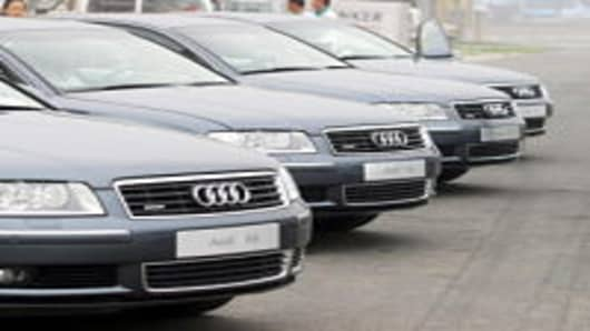 Chinese car buyers check out the German automaker's new Audi A8, in Beijing 28 July 2003. Sales of passenger cars in China rose 89 percent to 739,046 in the five months to May compared with the same period a year earlier, as for the month of May alone, sales reached 159,872 units, up 69 percent from a year ago.
