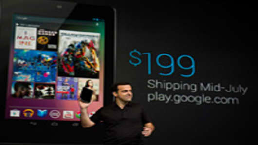 Hugo Barra, director of product management at Google Inc., holds the Nexus 7 tablet during the Google I/O conference in San Francisco, California, U.S., on Wednesday, June 27, 2012.
