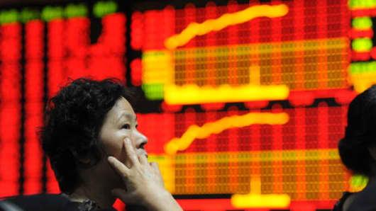 chinese stocks investor positive.jpg