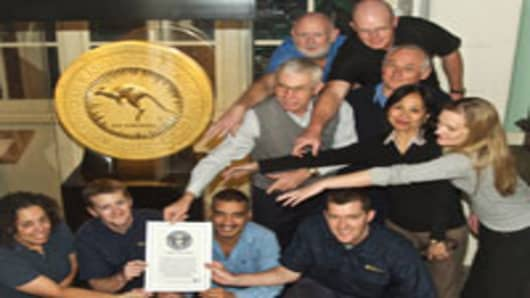 Staff of Perth Mint celebrating after their one-ton 2012 gold coin featuring a bounding red Kangaroo won the title of the world's largest by the Guinness World Records.