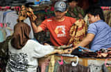 Residents shop for local goods at one of the downtown's busy sidewalk markets in Jakarta, Indonesia.