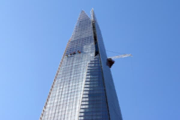 Workmen clean the exterior of The Shard on April 16, 2012 in London, England.