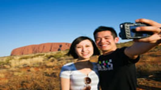 Chinese tourists at Uluru (Ayers Rock), UluruKata Tjuta National Park, Northern Territory, Australia