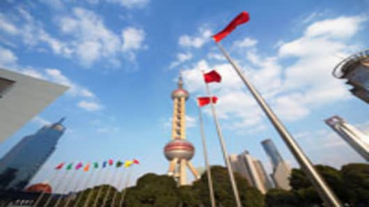 Chinese-flag-shanghai-skyline_200.jpg