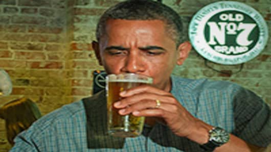 President Barack Obama drinks a beer at Ziggy's Pub and Restaurant in Amherts, Ohio.
