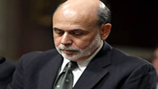 Federal Reserve Board Chairman Ben Bernanke prepares to testify before the Senate Banking, Housing and Urban Affairs Committee on Capitol Hill.