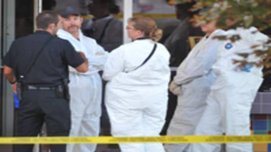 Investigators are on the scene at the Century 16 movie theatre where a gunmen attacked movie goers during an early morning screening of the new Batman movie, 'The Dark Knight Rises' July 20, 2012 in Aurora, Colorado.