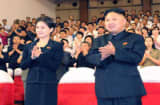 This file picture taken on July 6, 2012  shows North Korean leader Kim Jong Un, accompanied by a young woman Ri Sol-ju.