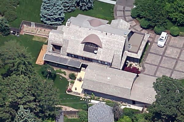 "Instead of owning a portfolio of homes, the ""Oracle of Omaha"" lives in just one. He paid $31,500 for his house in 1958, or about $250,000 in today's dollars. The house sits on a corner property in central Omaha, and the original 1921 stucco structure appears to have some additions.  At 6,570 square feet, it's no bungalow, butit's also a few thousand square feet short of being a mansion, which is usually about 10,000 square feet."