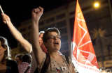 Supporters of Alexis Tsipras, the head of Syriza, celebrate outside the political party's election tent after beating the Pasok party in the parliamentary elections in Athens, Greece, on Sunday, May 6, 2012. Tsipras said voters had given him a mandate to renege on bailout agreements negotiated with the EU and the International Monetary Fund.